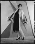 Peggy Hamilton modeling an Adrian coat in black chiffon velvet and cream broadcloth, 1929