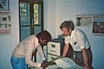 Bangladesh. Arthur Knudsen (right) at his office with a local employee, April 1983. Was sent by, Bangladesh. Arthur Knudsen (th) på sit kontor med en lokal medarbejder, april 1983. Var udsendt af DSM og Folkekirkens Nødhjælp til Pumpeprojektet i Chapai Nawabganj, 1983-84