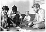 Saidpur, Bangladesh 1974. Activation of refugees is planned. From right to left: Niels Anton Da, Saidpur, Bangladesh 1974. Aktivering af flygtninge planlægges. Fra højre: Niels Anton Dam og sønnen Thorsten med lokale medarbejdere. (Arkitekt Niels Anton Dam var udsendt af Dansk Santalmission til Øst Pakistan, 1966-69 samt af Danida til Bangladesh, 1974-77, hvor han var leder af stort rehabiliterings-projekt for flygtninge)