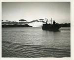 Cargo ship in silhouette