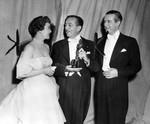 Walt Disney receives Oscar from Jane Wyman