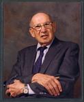 Color portrait photograph of Peter Drucker, arms folded