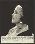 Peggy Hamilton modeling a velvet hat and a long dress of chiffon velvet and Alençon lace, 1930