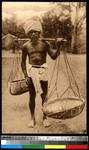 Elderly man with baskets, India, ca.1920-1940