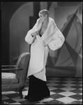 Peggy Hamilton modeling a white ermine coat, 1930
