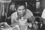 Vietnamese man eating
