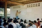 Basalong is teaching simple English to young people underneath the Team House, Basalong underviser unge mennesker i grundlæggende engelsk under team-huset